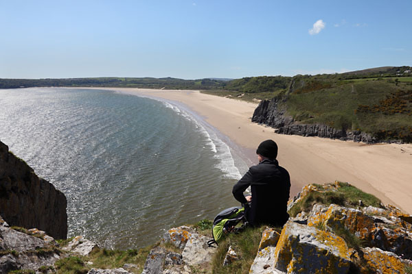 04D-8093 Walker Enjoying the View Over the Golden Sands of Oxwich Bay From Great Torr Penmaen Burrows Gower Wales UK