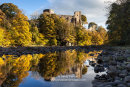The medieval ruins of Barnard Castle reflected in the River Tees in Autumn, Barnard Castle, Teesdale, County Durham, UK