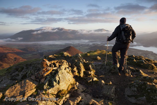 05D-8938 Hill Walker on the Summit of Causey Pike at Sunrise Enjoying the View Towards Skiddaw Lake District Cumbria UK