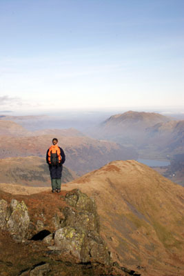 06-2207 Hill walker enjoying the view north over Brothers Water from Red Screes, Lake District, Cumbria