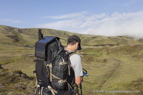 06D-0530 Hiker Using With Solar Panel on Rucksac in Iceland