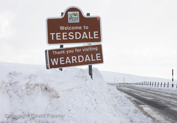 06D-2314 Snow piled up against a road sign on the B6278 at the Teesdale Weardale Border in County Durham