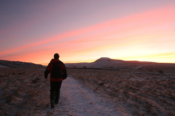07-0764 Hill Walker Crossing Scales Moor in Dawn Winter Light with Ingleborough Hill as a Backdrop, Twistleton, North Yorkshire
