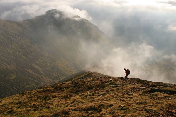 07-1139 Walker Descending the South Ridge of Grasmoor (Lad Howes) in Swirling Mist, Lake District, Cumbria