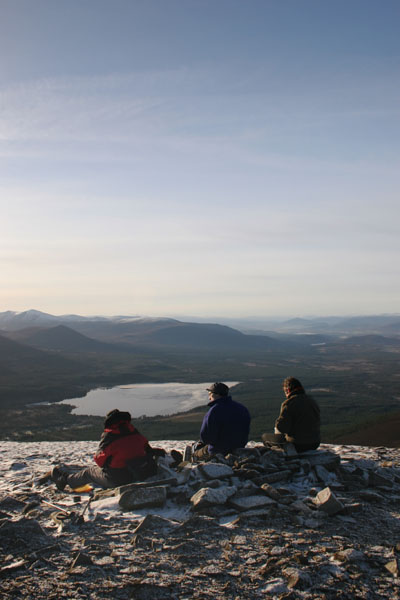 07-4701 Three Walkers Enjoying the Winter View Over Loch Morlich From Meall a' Bhauchaille Cairngorms Scotland