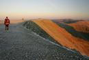 205-0601 Walker Approaching the Summit of Helvellyn at Dawn.  Lake District, Cumbria