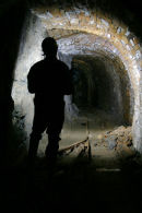 D9 120 Silhouette of a Caver in Mine Passage Brownley Hill Mine Cumbria