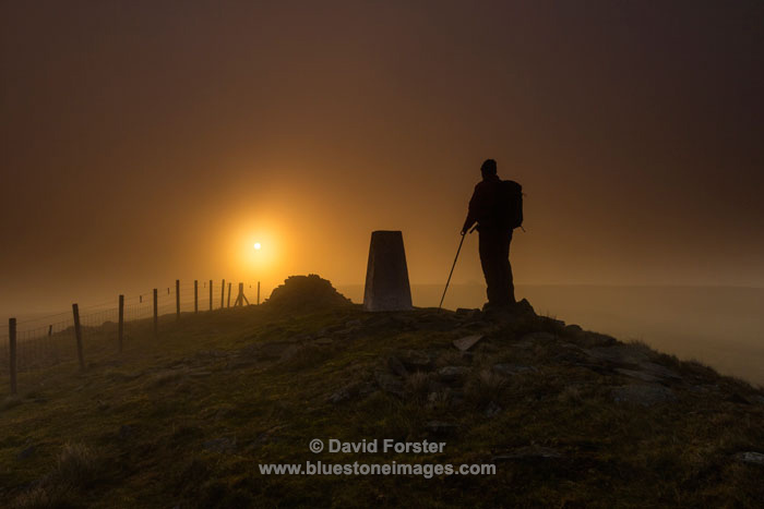 Hiker at Sunrise on Great Stony Hill, Teesdale, County Durham UK.