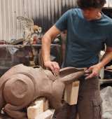Creating a clay badger using coils of clay