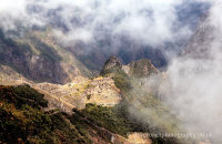 Machu Picchu appearing through the mist