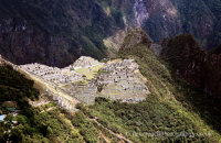 Machu Picchu lit up by sunlight, taken from the Sun Gate trail