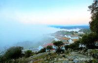 Sierra Morena morning-mist rolling in over Virgen de la Cabeza