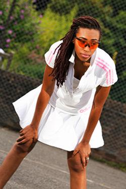 Ashani wearing Oakley Carbon Framed with Orange Persimon Lense Glasses