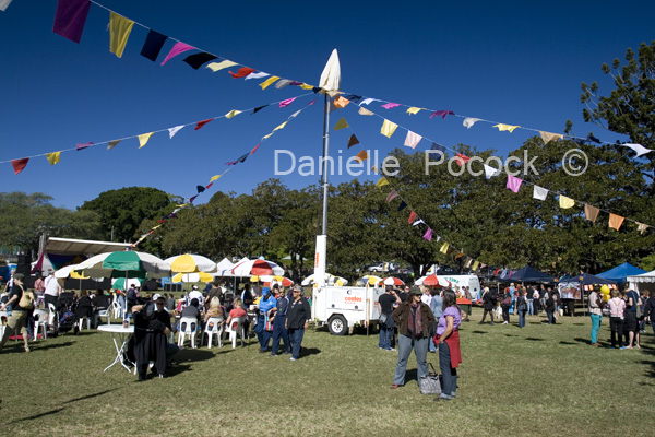 People enjoy the sunshine, entertainment and good company at the 2010 Brisbane Pride Fair Day.