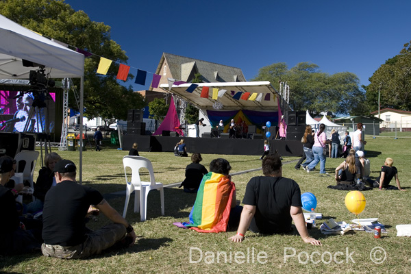 Attendees at the 2010 Brisbane Pride Fair Day relax and enjoy the entertainment on the main stage.