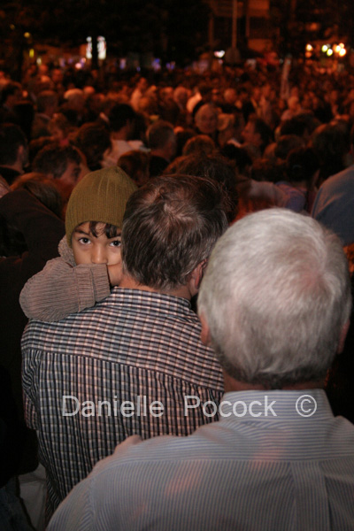 A young boy clings to his father at the Anzac Day Dawn Service, Currumbin 2007.