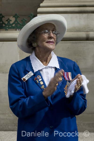A woman applauds the marchers of the Anzac Day March 2010 in Brisbane.