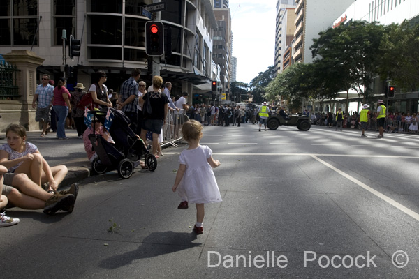 A young girl marches to the beat of drums echoing through the streets of Brisbane during the Anzac Day March 2010.