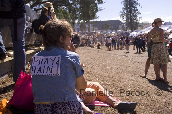 A woman watches the 2007 Paniyiri Greek Festival on the grass of Musgrave Park