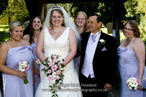 BRIDE, FATHER AND BRIDESMAIDS ARRIVE AT CHURCH