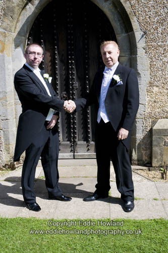 GROOM AND FATHER AFTER SERVICE
