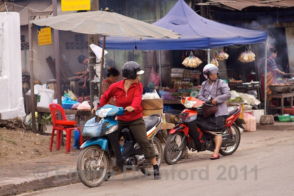 Locals on mopeds