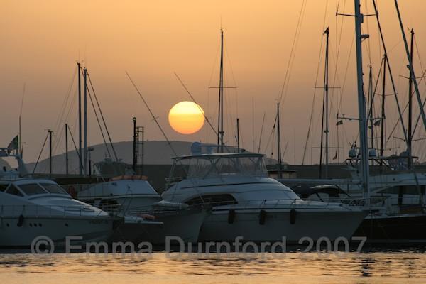 Sunset over Alghero Marina