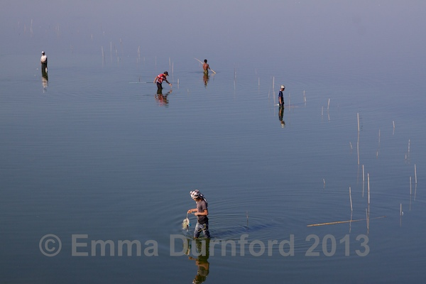 Fishermen in the Taungthaman Lake
