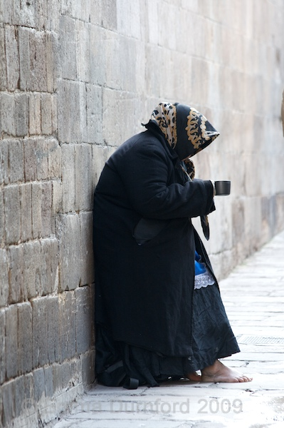 Begging by the cathedral