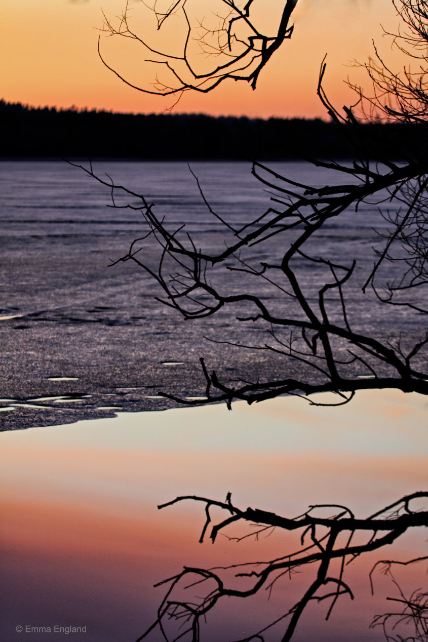 Frozen lake at sunset
