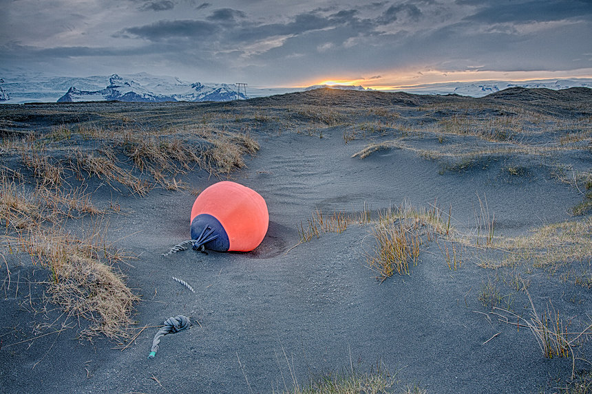 A washed-up buoy in the sand and gravel dunes near Jökulsárlón glacial lake, Iceland.