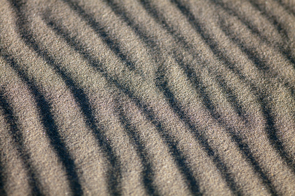 Ripples in the sand. Canon 50D, Canon EF 400mm f/5.6 L USM, 1/400, f/5.6, iso 125, handheld.