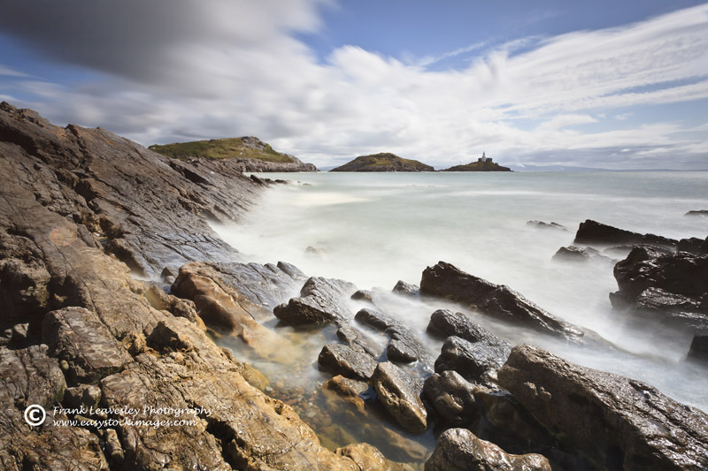 Rocky Shore And Mumbles Lighthouse