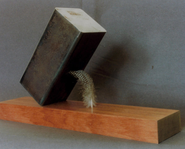 Steel Block supported by a Feather