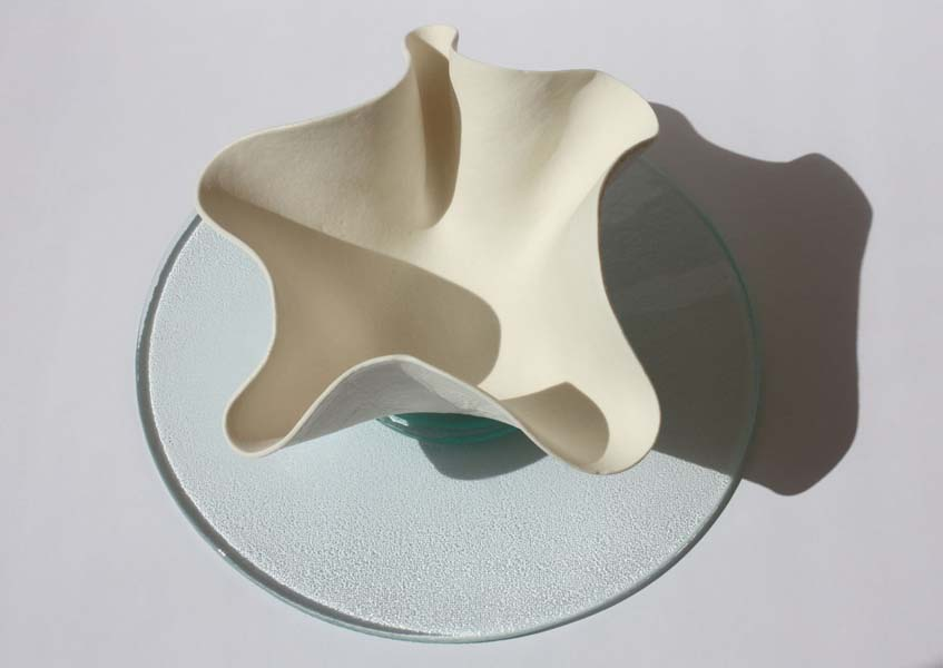 Wavy Medium  Bowl in Porcelain on float glass top view