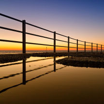 Reflections of railings in puddle at dawn Geoff Carpenter GRCL3675 copy