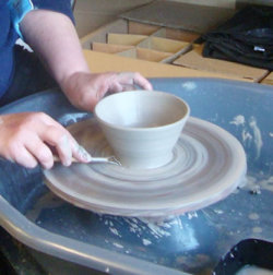 Throwing on the potters wheel