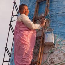Nun on a ladder