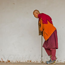 Old monk with crutch