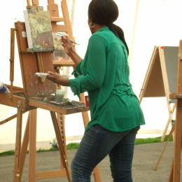 Angelica Bell painting one of the 96 panels