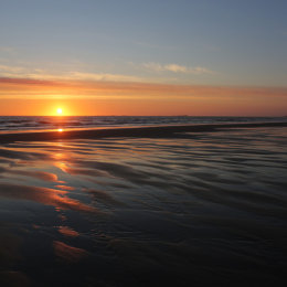 Sunrise taken from Ross Sands looking towards the Farne Islands and Bamburgh Castle, Northumbria