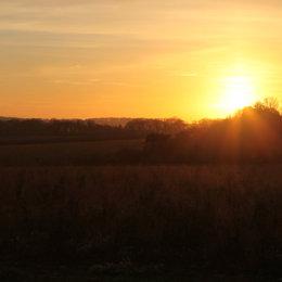 Sunset across fields, Thornham, North Norfolk