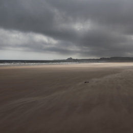 Stormy skies over Bamburgh, taken from Ross Sands, Northumbria