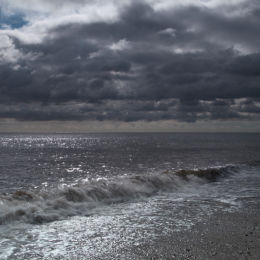 Stormy morning sky along Dunwich Beach, Suffolk