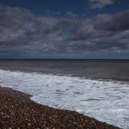 View along Dunwich Beach looking towards Southwold, Suffolk