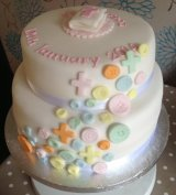Buttons Christening cake 2 tier from £55