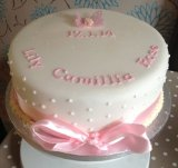 Ribbon and dots Christening cake (feeds 25) from £40