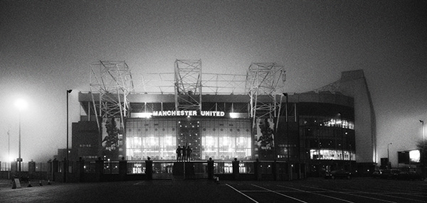 Manchester united fcs stadium at old trafford photographed shortly before dawn in some wonderful winter mist