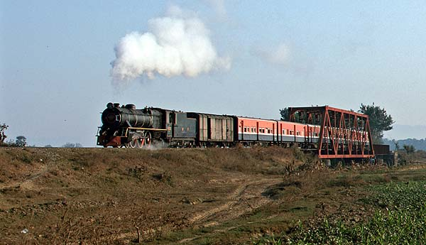 YC 629 crosses a river bridge near Pyinmana.