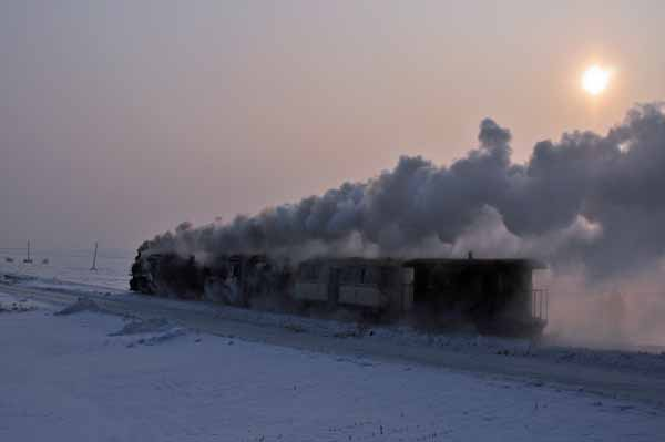 The train continues on to clear the deep snow as the sun rises at 0830.